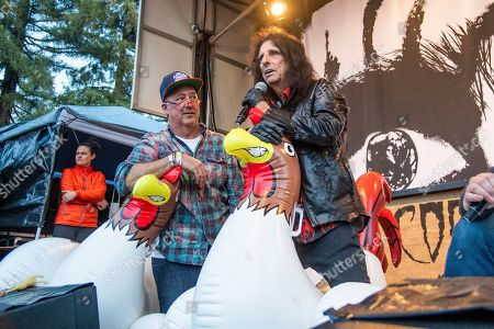 Stock Photo of Andrew Zimmern, Alice Cooper. Andrew Zimmern, left, and Alice Cooper are seen at the BottleRock Napa Valley Music Festival at Napa Valley Expo as they attempt to break a world record, in Napa, Calif