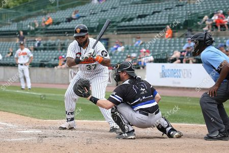 Long Island Duck's catcher, Hector Sanchez bats during an Atlantic League of Professional Baseball game on in Central Islip, N.Y