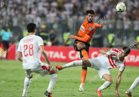 Al Zamalek player Mohamed Ali (R) and Mahmoud Hamdy (L) in action against RSB Barkane Club player Mohamed Farhane (C) during the CAF Confederations Cup final match between Al Zamalek and RSB Barkane Club at Borg El Arab Stadium in Alexandria, Egypt, 26 May 2019.