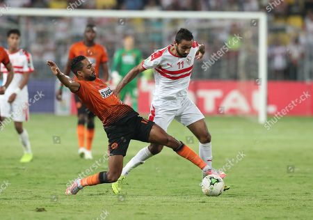 Al Zamalek player Mahmoud Kahraba (R) in action against RSB Barkane Club player Amine El Kass (L) during the CAF Confederations Cup final match between Al Zamalek and RSB Barkane Club at Borg El Arab Stadium in Alexandria, Egypt, 26 May 2019.
