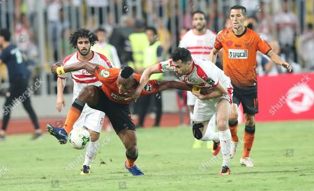 Al Zamalek player Mahmoud Hamdy (R) in action against RSB Barkane Club player Kodjo Fo-Doh Laba (C) during the CAF Confederations Cup final match between Al Zamalek and RSB Barkane Club at Borg El Arab Stadium in Alexandria, Egypt, 26 May 2019.