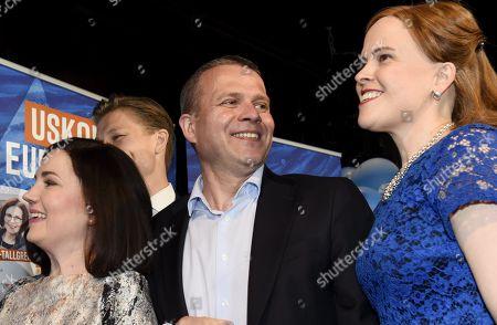 Sanni Grahn-Laasonen, chairman Petteri Orpo and Mari-Leena Talvitie