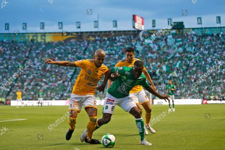 Leon's Joel Campbell, right, and Tigres' Luis Rodriguez fight for the ball during the final Mexico soccer league championship match in Leon, Mexico