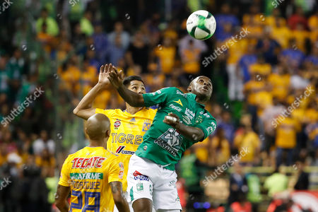 Leon's Joel Campbell, right, tries to head the ball during the final Mexico soccer league championship match against Tigres in Leon, Mexico