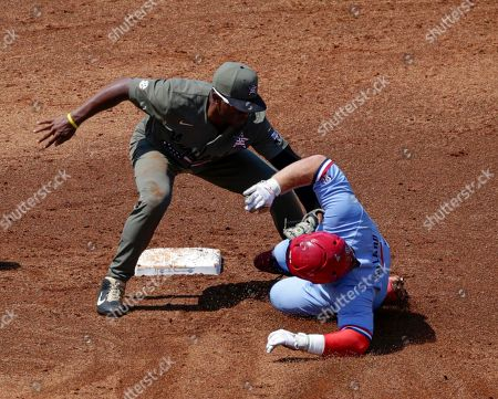 Harrison Ray, Thomas Dillard. Vanderbilt second baseman Harrison Ray (2) tags Mississippi's Thomas Dillard (6) out as he slides into second base during the first inning of the Southeastern Conference tournament NCAA college baseball championship game, in Hoover, Ala