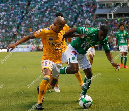 Joel Campbell (R) of Leon in action against Luis Rodriguez (L) of Tigres UANL during the Clausura Tournament finals soccer match between Leon and Tigres UANL, at the Leon Stadium, in Leon, Guanajuato state, Mexico, 26 May 2019.