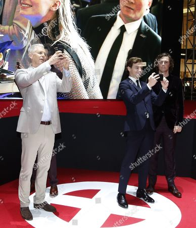 Hutch Parker (L) and cast members Tye Sheridan (C) with Evan Peters (R) take selfie pictures as they arrive at the premiere of X-Man: Dark Phoenix at Lotte World Tower Special Outdoor Stage in Seoul, South Korea, 27 May 2019. The movie will open in South Korean theaters on 05 June 2019.