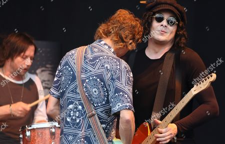 (L to R) Patrick Keeler, Brendan Benson and Jack White of The Raconteurs seen performing live on stage