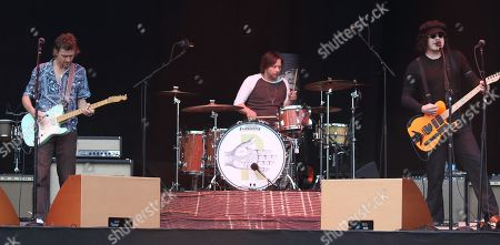 (L to R) Brendan Benson, Patrick Keeler and Jack White from The Raconteurs seen performing live on stage