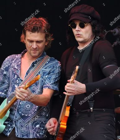 Brendan Benson (L) and Jack White from The Raconteurs seen performing live on stage