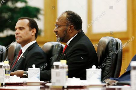 Vanuatu Prime Minister Charlot Salwai (R) attends a meeting with Chinese Premier Li Keqiang (not pictured) at the Great Hall of the People in Beijing, China, 27 May 2019.