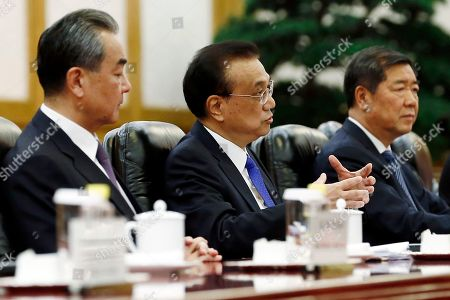 Chinese Premier Li Keqiang (C) attends a meeting with Vanuatu Prime Minister Charlot Salwai (not pictured) at the Great Hall of the People in Beijing, China, 27 May 2019.