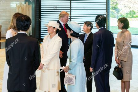 In this photo released by Imperial Household Agency of Japan, U.S. President Donald Trump, rear left, and first lady Melania Trump, left, talk with Japan's Emperor Naruhito, third right, Empress Masako, third left, Crown Prince Akishino, second left, Crown Princess Kiko, front right, Japan's Prime Minister Shinzo Abe, second right, and his wife Akie during their state call at the Imperial Palace in Tokyo
