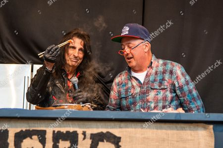 Andrew Zimmern, Alice Cooper. Alice Cooper, left, and Andrew Zimmern are seen at the BottleRock Napa Valley Music Festival at Napa Valley Expo, in Napa, Calif