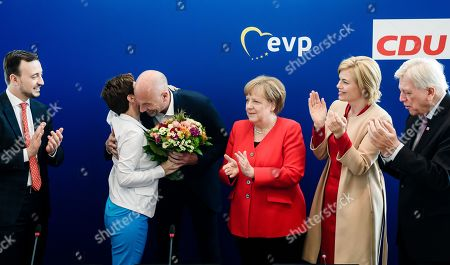 Christian Democratic Party (CDU) top candidate for the regional election in the German federal state of the city Bremen, Carsten Meyer-Heder (3-L) receives flowers from party chairwoman Annegret Kramp-Karrenbauer (2-L), next to Secretary General Paul Ziemiak (L), German Chancellor Angela Merkel, Minister of Food and Agriculture and deputy leader Julia Kloeckner (2-R) and Premier of Hesse and deputy leader Volker Bouffier (R) during the beginning of a CDU board meeting following the European Parliament election and the regional election for the German federal state of Bremen in Berlin, Germany, 27 May 2019. The European Parliament election was held by member countries of the European Union (EU) from 23 to 26 May 2019. The German Christian Democrats suffered from losses.