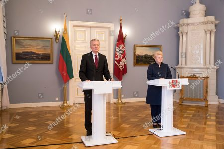 Gitanas Nauseda, Dalia Grybauskaite. Lithuanian President-elect Gitanas Nauseda, left, speaks during a joint press conference with Lithuania's President Dalia Grybauskaite, at the President's palace in Vilnius, Lithuania