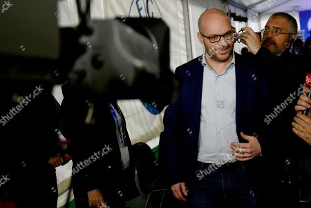 Family Minister Lorenzo Fontana has an earphone fixed for an interview at the League Party headquaters in Milan, Italy, 27 May 2019. The European Parliament election was held by member countries of the European Union (EU) from 23 to 26 May 2019.