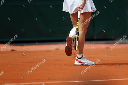 Stock Image of Denmark's Caroline Wozniacki tops the clay of her shoes during her first round match of the French Open tennis tournament against Russia's Veronika Kudermetova at the Roland Garros stadium in Paris