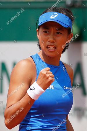China's Zhang Shuai clenches her fist after scoring a point against Varvara Lepchenko of the U.S. during their first round match of the French Open tennis tournament at the Roland Garros stadium in Paris