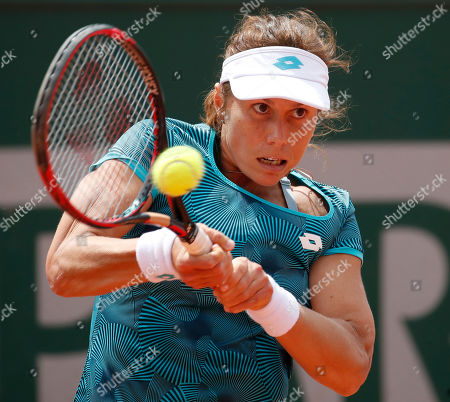 Varvara Lepchenko of the U.S. plays a shot against China's Zhang Shuai during their first round match of the French Open tennis tournament at the Roland Garros stadium in Paris