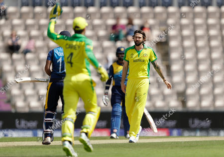 Australia's Kane Richardson, right, celebrates taking the wicket of Sri Lanka's captain Dimuth Karunaratne, left, caught by Australia's Alex Carey, second left, during the Cricket World Cup warm-up match between Australia and Sri Lanka at the Hampshire Bowl in Southampton, England