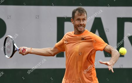 Stock Photo of Lukas Rosol of the Czech Republic plays Lloyd Harris of South Africa during their men?s first round match during the French Open tennis tournament at Roland Garros in Paris, France, 27 May 2019.