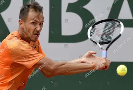 Stock Image of Lukas Rosol of the Czech Republic plays Lloyd Harris of South Africa during their men?s first round match during the French Open tennis tournament at Roland Garros in Paris, France, 27 May 2019.