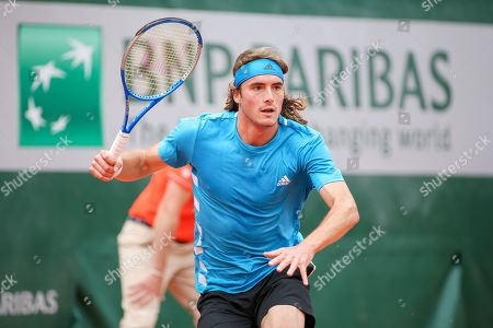 Stock Photo of Stefanos Tsitsipas of Greece during the men's singles first round match of the French Open tennis tournament against Maximilian Marterer of Germany at the Roland Garros in Paris, France.