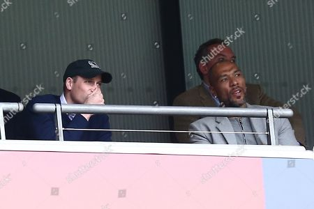 Stock Photo of Prince William in the stands with former player John Carew