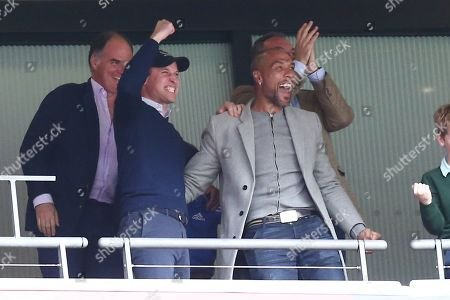 Prince William celebrates the 1st goal scored by Anwar El Ghazi of Aston Villa with former player John Carew