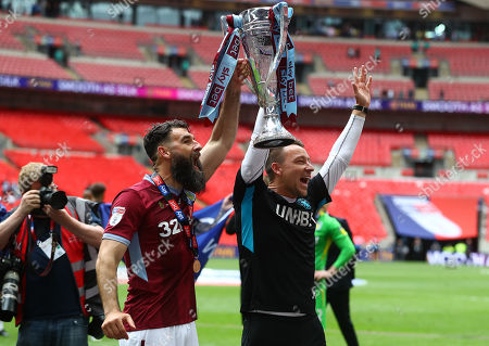 Mile Jedinak and John Terry celebrate with the trophy