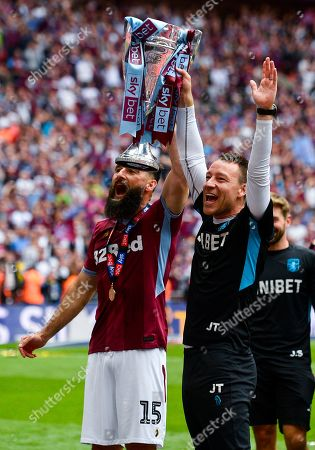 Stock Photo of Mile Jedinak of Aston Villa and John Terry assistant nmanager of Aston Villa celebrate at full time