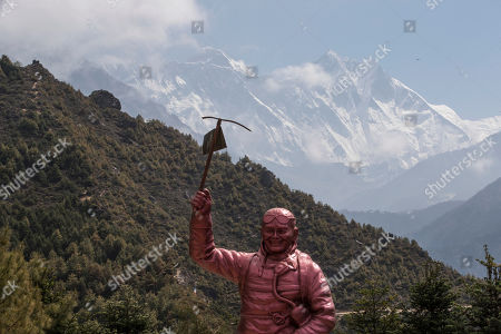 Statue of Sherpa Tenzing Norgay, One of the first people to summit first Mount Everest, as Mount Everest (behind left) is seen, during cleaning campaign to the Everest Mount at Namche Bazar, Solukhumbu district, Nepal 27 May 2019. A total 10,000 Kilograms of trash and four dead bodies found in the Everest summits during a massive cleaning campaign organized by the Nepalese stakeholders. The collected trash will be sent to Kathmandu to be recycled.