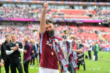 A thumbs up for the fans from Aston Villa midfielder Mile Jedinak (15) during the EFL Sky Bet Championship play off final match between Aston Villa and Derby County at Wembley Stadium, London