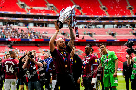 Alan Hutton of Aston Villa celebrates his side winning the Sky Bet Championship Playoff Final and winning promotion to the Premier League