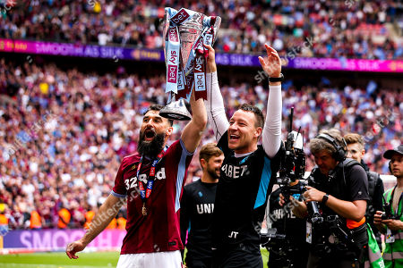 Mile Jedinak of Aston Villa and Aston Villa Assistant Manager John Terry celebrate winning promotion to the Premier League after beating Derby County in the Sky Bet Championship Playoff Final