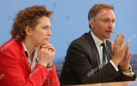 Stock Photo of Nicola Beer, lead candidate for the German Free Democrats (FDP) party (L), and Christian Lindner, head of the FDP, attend a news conference at the Bundespressekonferenz in Berlin, Germany, 27 May 2019. European parliamentary election results, with the highest voter turnout in at least 20 years, were announced the previous evening.