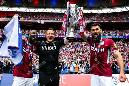 Albert Adomah, John Terry, Mile Jedinak and Aston Villa celebrate after they win the Sky Bet Championship Play-Off Final 2-0 and secure promotion back to the Premier League