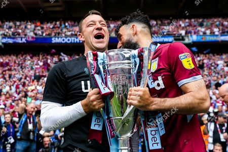 John Terry, Mile Jedinak and Aston Villa celebrate after they win the Sky Bet Championship Play-Off Final 2-0 and secure promotion back to the Premier League