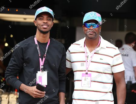 Stock Picture of Destin Christopher and Chris Tucker pose in pit lane during the Grand Prix