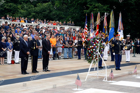 Mike Pence, Patrick Shanahan, Michael Howard. Vice President Mike Pence, from left, U.S. Army Maj. Gen. Michael Howard and acting Defense Secretary Patrick Shanahan pause during a wreath-laying ceremony at the Tomb of the Unknown Soldier in observance of Memorial Day, at Arlington National Cemetery in Arlington, Va