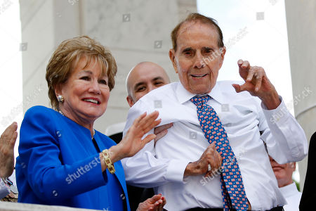 Bob Dole, Elizabeth Dole. Former Sen. Bob Dole, right, and his wife Elizabeth Dole acknowledge well-wishers during a Memorial Day ceremony, at Arlington National Cemetery in Arlington, Va