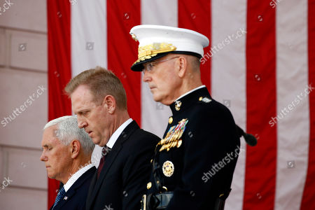 Joseph Dunford, Mike Pence, Patrick Shanahan. Vice President Mike Pence, from left, Acting Defense Secretary Patrick Shanahan and Joint Chiefs Chairman Gen. Joseph Dunford pause during a prayer, during a Memorial Day ceremony at Arlington National Cemetery in Arlington, Va