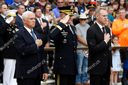 Mike Pence, Patrick Shanahan, Michael Howard. Vice President Mike Pence, from left, U.S. Army Maj. Gen. Michael Howard and Acting Defense Secretary Patrick Shanahan participate in a wreath-laying ceremony at the Tomb of the Unknown Soldier in observance of Memorial Day, at Arlington National Cemetery in Arlington, Va