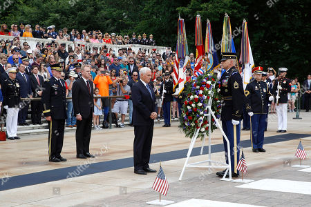 Mike Pence, Patrick Shanahan, Michael Howard. Vice President Mike Pence, center, pauses after placing a wreath in front of the Tomb of the Unknown Soldier in observance of Memorial Day, at Arlington National Cemetery in Arlington, Va. Standing behind Pence are U.S. Army Major General Michael Howard, left, and acting Defense Secretary Patrick Shanahan