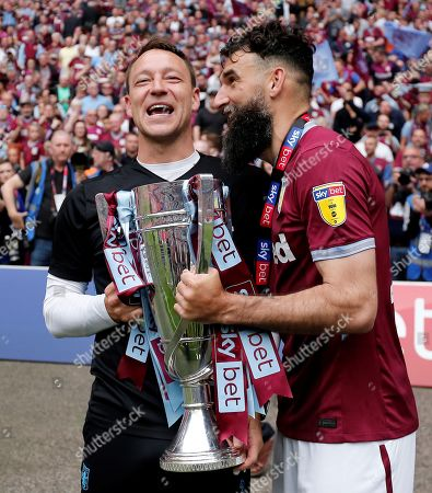 Stock Image of Aston Villa assistant head coach  John Terry and  Mile Jedinak with the winners trophy