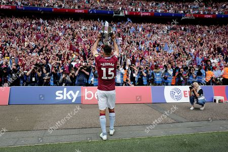 Mile Jedinak of Aston Villa  celebrates with the winner trophy