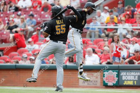 Starling Marte, Josh Bell. Pittsburgh Pirates' Starling Marte (6) celebrates with Josh Bell (55) after hitting a two-run home run off Cincinnati Reds relief pitcher David Hernandez in the eighth inning during the first baseball game of a doubleheader, in Columbus