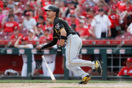 Pittsburgh Pirates' Bryan Reynolds hits a two-run double off Cincinnati Reds relief pitcher David Hernandez in the eighth inning during the first baseball game of a doubleheader, in Columbus