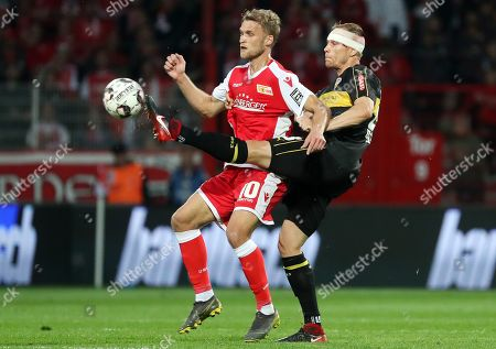 Union's Sebastian Andersson (L) in action against Stuttgart's Holger Badstuber (R) during the German Bundesliga relegation playoff second leg soccer match between FC Union Berlin and VfB Stuttgart in Berlin, Germany, 27 May 2019. The match ended 0-0 and Union beat Stuttgart on away goals following a 2-2 draw in the first leg to promote to the German Bundesliga.
